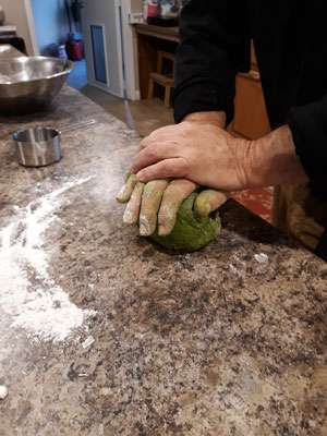 Kneading the dough for the green algae noodles